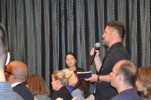 Christian Sorace asking a question from the audience